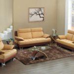 Canapele din piele in doua culori mari inchis si crem